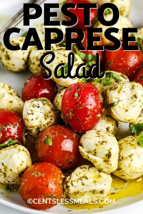 Pesto Caprese Salad on a white plate with writing