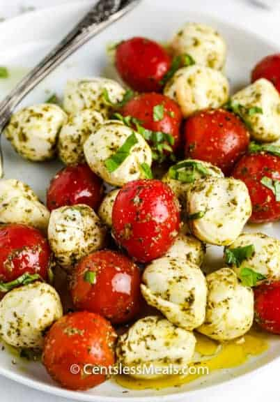 Pesto Caprese Salad on a white plate