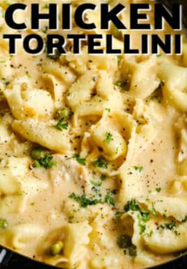 Crockpot Chicken Tortellini in a slow cooker after cooking, with a title.