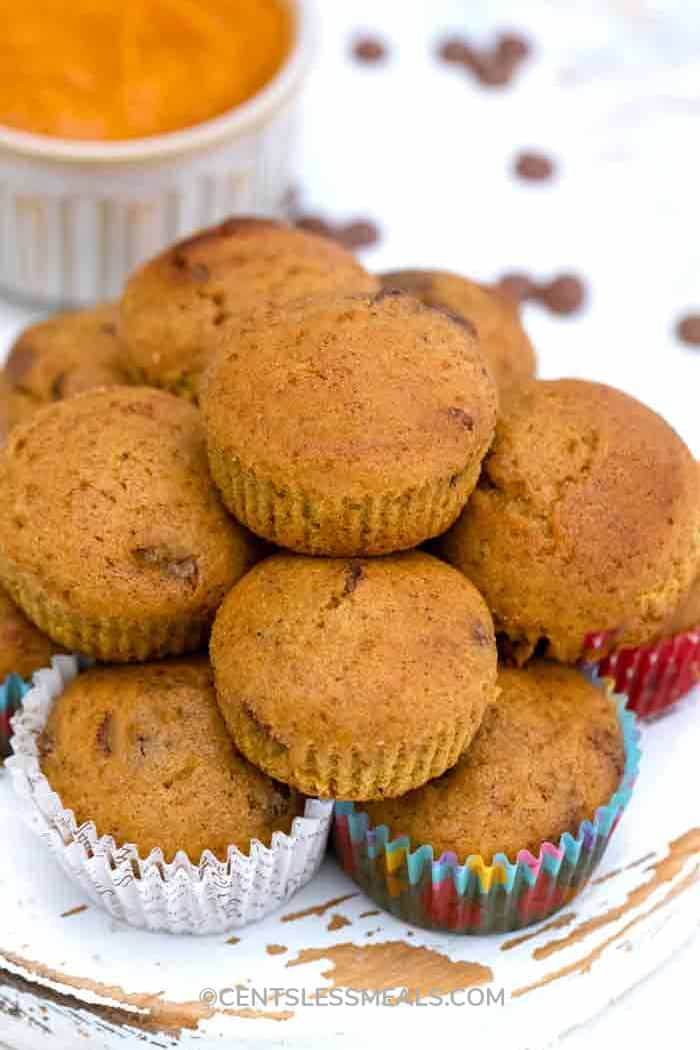 chocolate chip pumpkin muffins piled upon each other