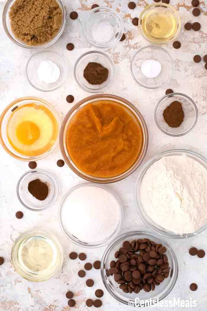 chocolate chip pumpkin muffins ingredients on a white background.