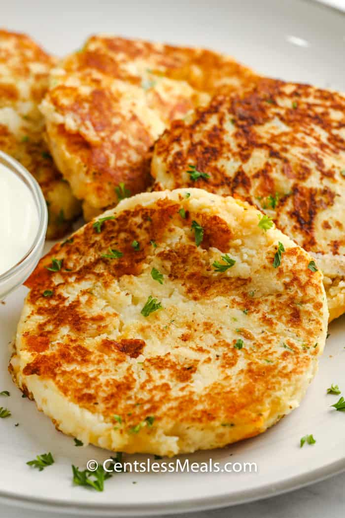 Loaded Mashed Potato Pancakes on a plate with garnish