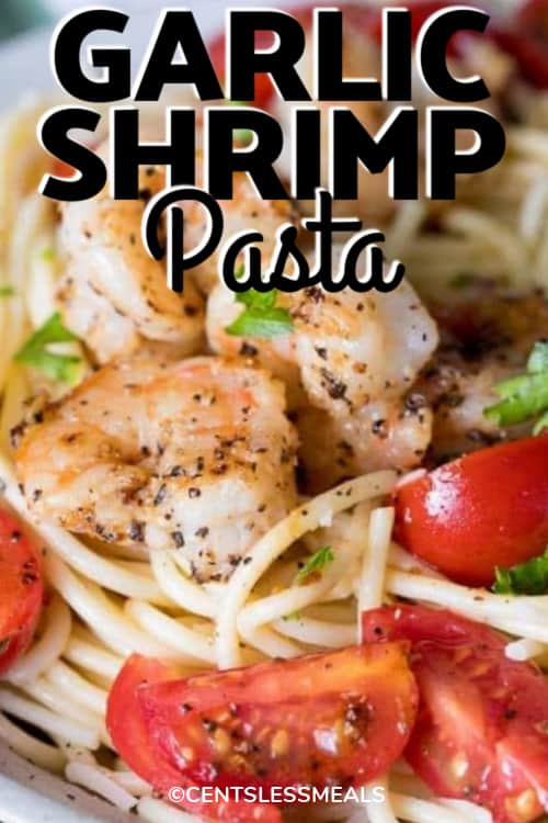 Garlic Shrimp Pasta on a white plate with writing