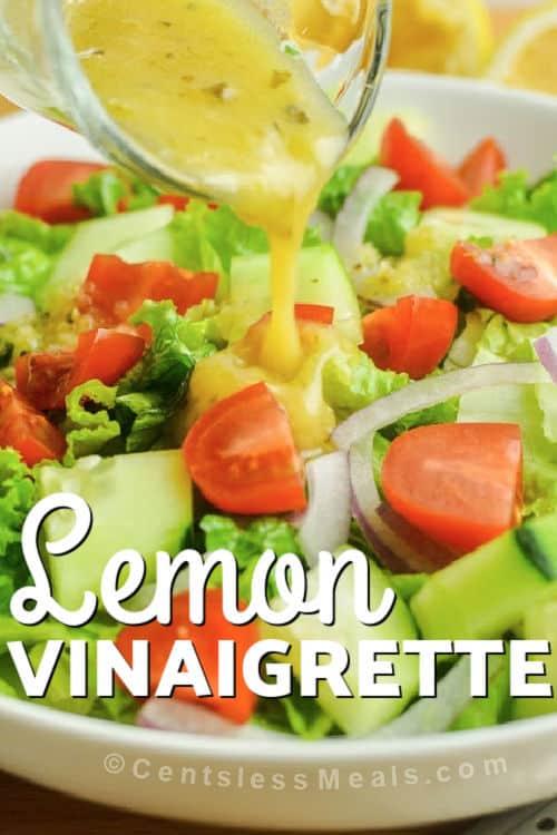 Lemon Vinaigrette poured over salad with writing