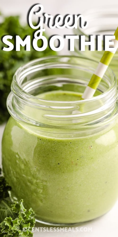 A Green Smoothie in a glass jar with a green and white striped straw with writing