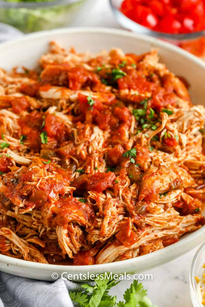 shredded chicken in a white bowl to make Crock Pot Chicken Tacos