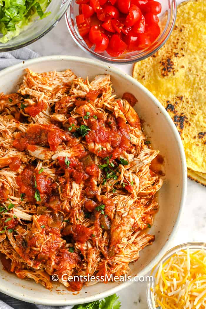 top view of ingredients to make Crock Pot Chicken Tacos in bowls