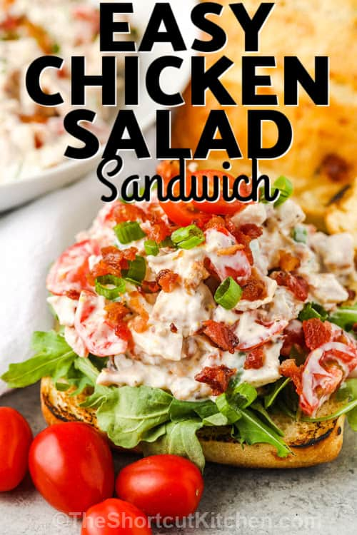 open faced BLT Rotisserie Chicken Salad with tomatoes on the side and writing.