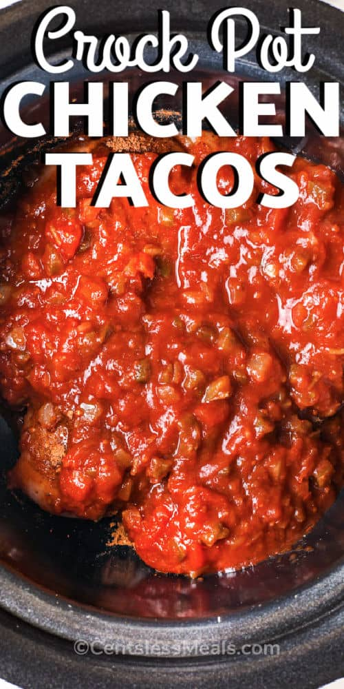 salsa and chicken in crock pot to make Crock Pot Chicken Tacos with a title