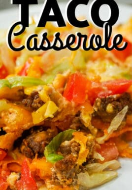 taco casserole on a white plate with writing