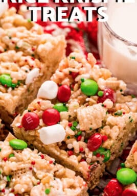 close up of Christmas Rice Krispie Treats with a glass of milk and writing
