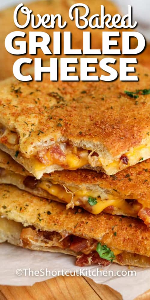 Oven Baked Grilled Cheese piled up and the top one with a bite taken out, with a title