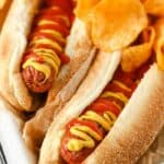 Air Fryer Hot Dogs plated with chips