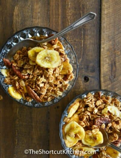top view of Banana Bread Granola in a bowl with a spoon