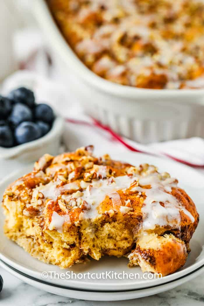 plated Cinnamon Roll French Toast Casserole with dish full in the back