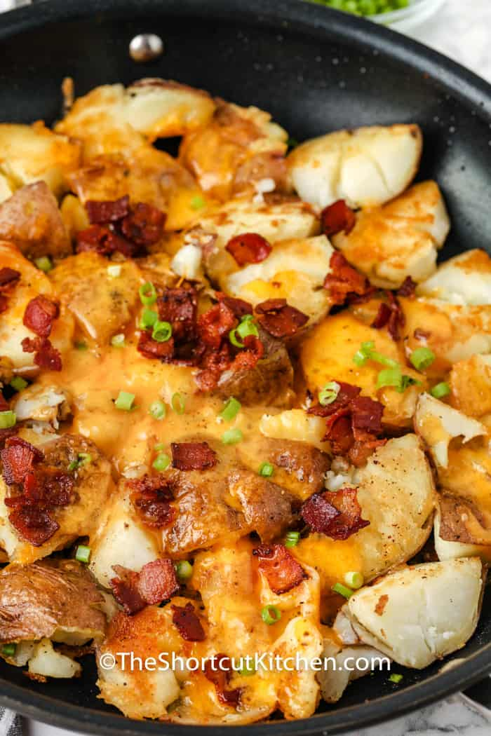 close up of Crispy Smashed Potatoes in the pan