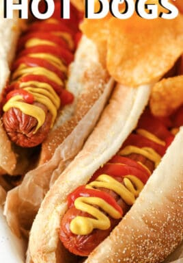 close up of air fryer baked hot dogs with a title