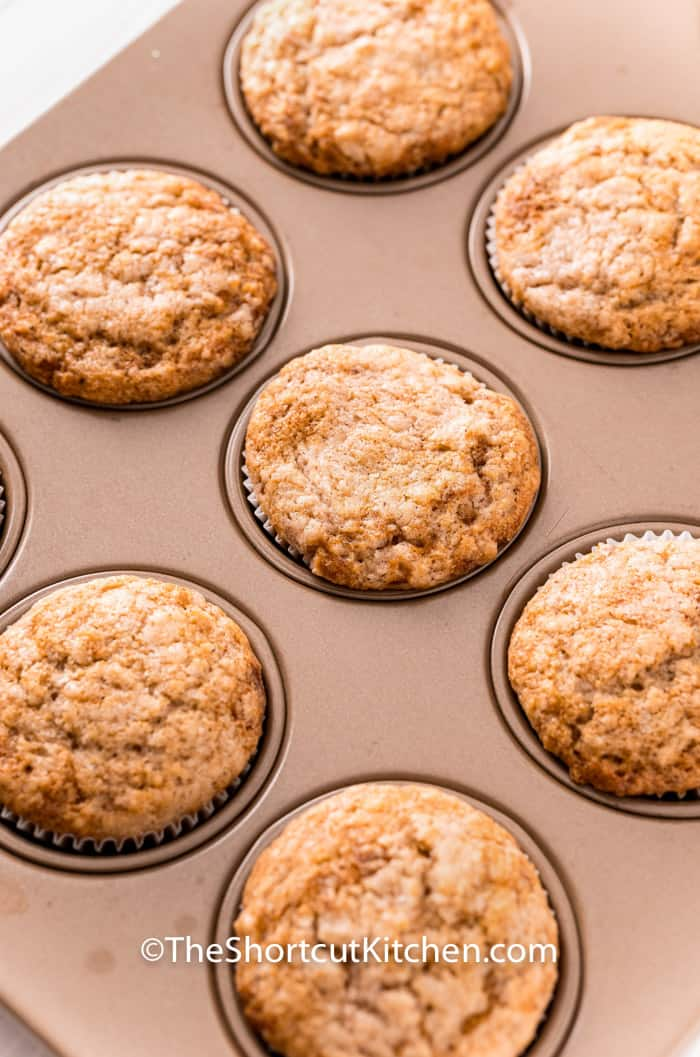 close up of cooked Cinnamon Sugar Muffins in the muffin tin