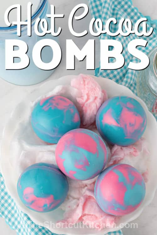 Cotton Candy Hot Cocoa Bombs in a bowl with writing