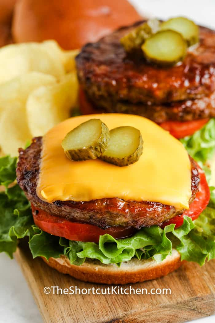 Air Fryer Frozen Burgers with cheese on a bun