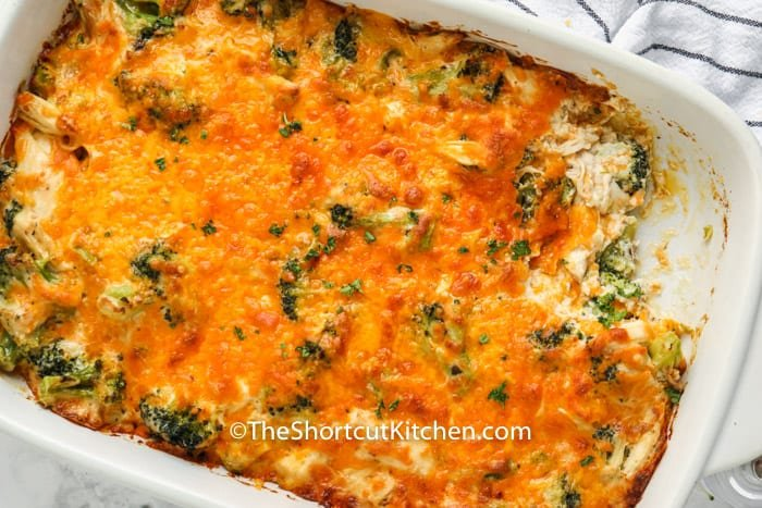 casserole dish full of Chicken Broccoli Casserole with a portion taken out