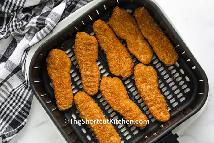 cooked Air Fryer Frozen Chicken Tenders in the air fryer