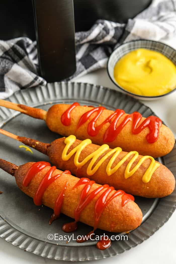 Air Fryer Frozen Corn Dogs on a plate with mustard dip