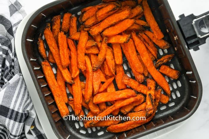 top view of cooked Air Fryer Frozen Sweet Potato Fries in the fryer