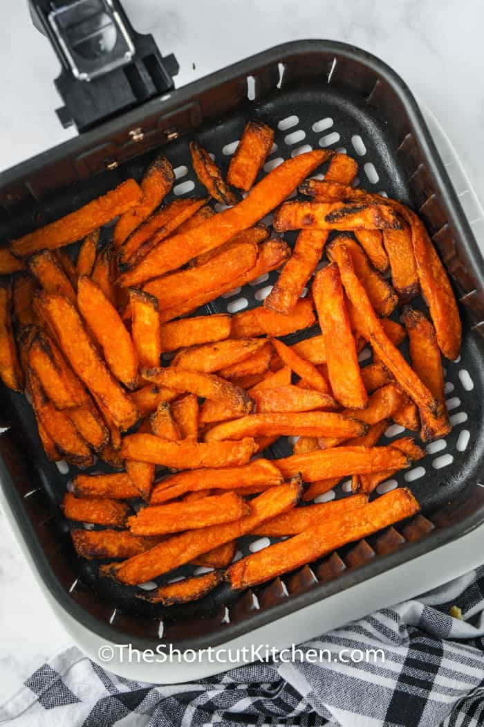 top view of Air Fryer Frozen Sweet Potato Fries in the air fryer cooked