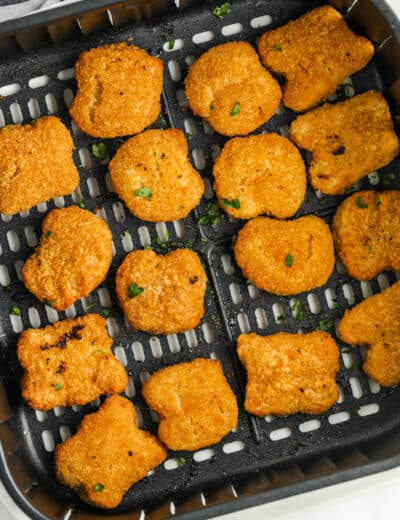 close up of cooking Air Fryer Frozen Chicken Nuggets in the air fryer
