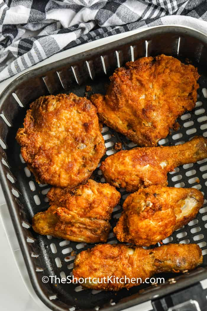 cooked chicken in the air fryer to show How to Reheat Fried Chicken in the Air Fryer