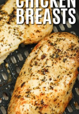 close up of Air Fryer Frozen Chicken Breasts cooking with a title