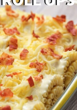 Chicken Bacon Alfredo Roll Ups in the dish with a title