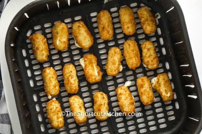 cooked Air Fryer Frozen Mozzarella Sticks in the air fryer