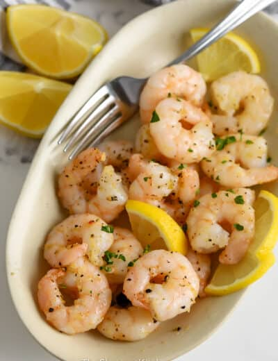 Air Fryer Frozen Shrimp cooked and served in an oval dish.