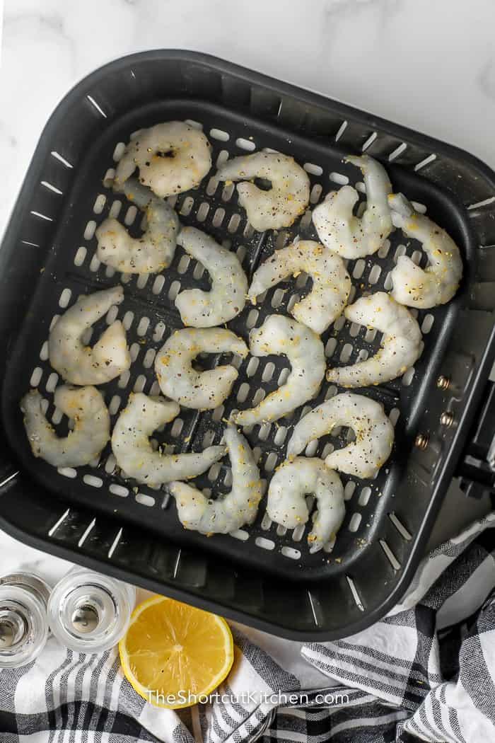 Frozen shrimp in the bottom of an air fryer basket