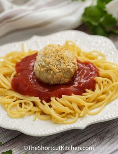 Chicken Parmesan Meatballs on spaghetti