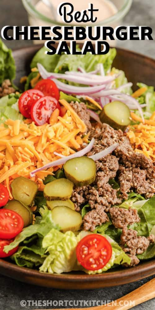 plated Cheeseburger Salad with writing