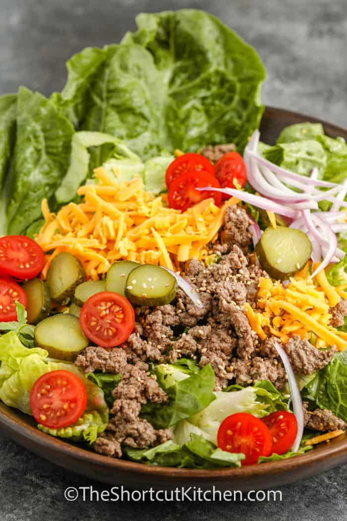 Cheeseburger Salad in a bowl with pickles