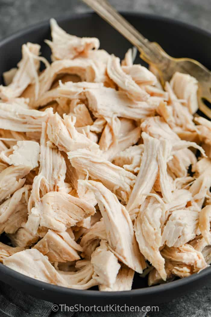 Easy Shredded Chicken in a pan with a fork