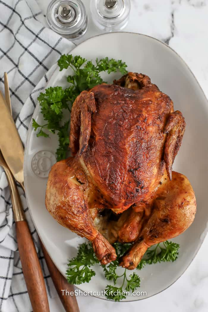cooked rotisserie chicken with parsley