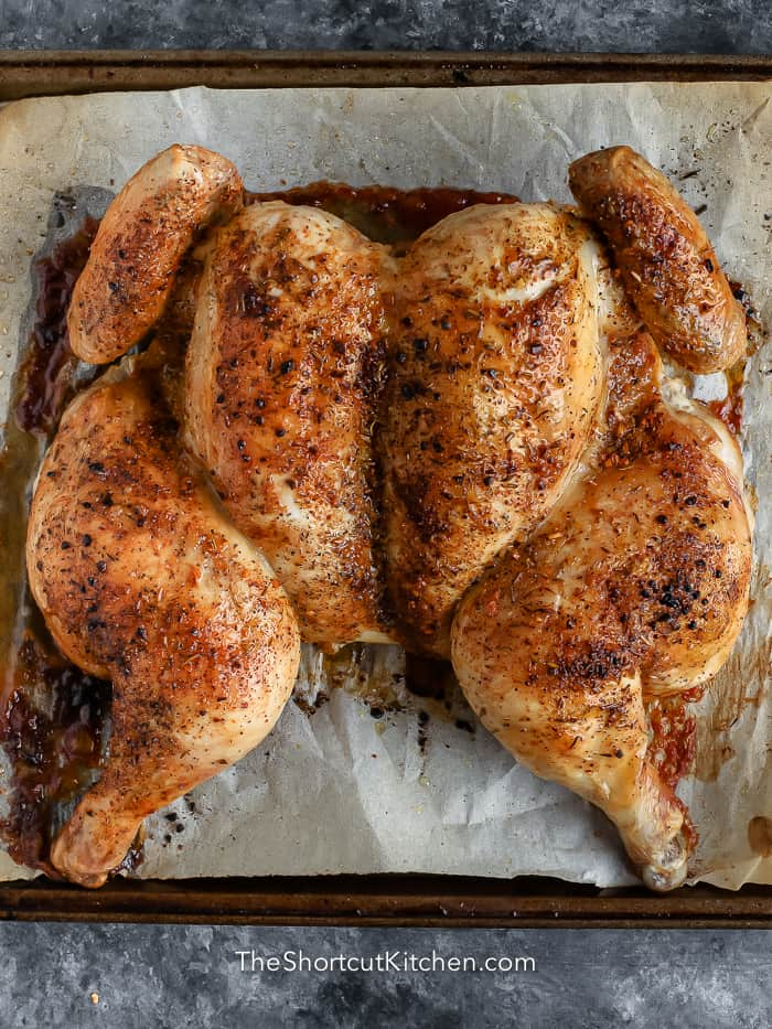 cooked whole chicken on tray