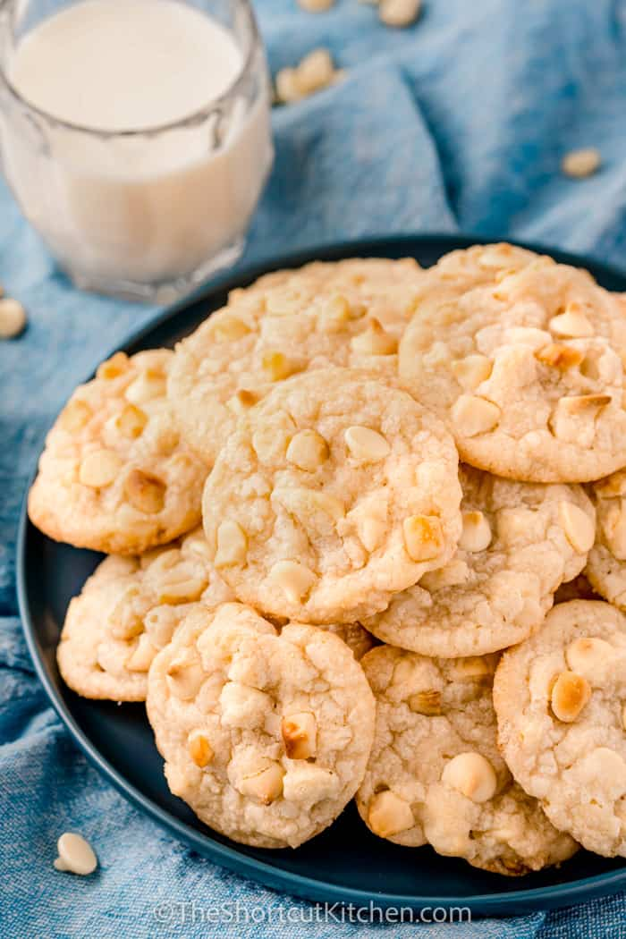 close up of White Chocolate Macadamia Nut Cookie Recipe baked on a. plate