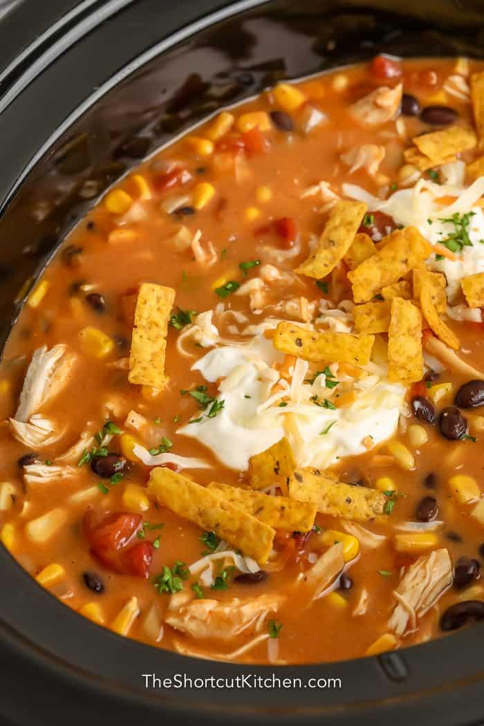 close up of crock pot chicken tortilla soup in crock pot