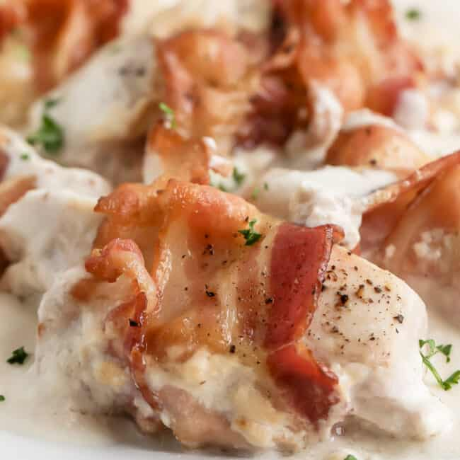 close up of bacon wrapped sour cream chicken
