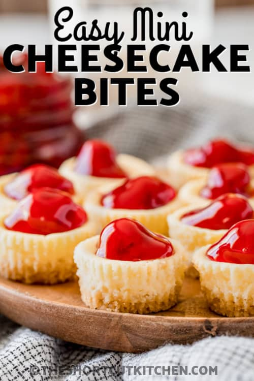 a serving tray with mini cherry cheesecake bites with text