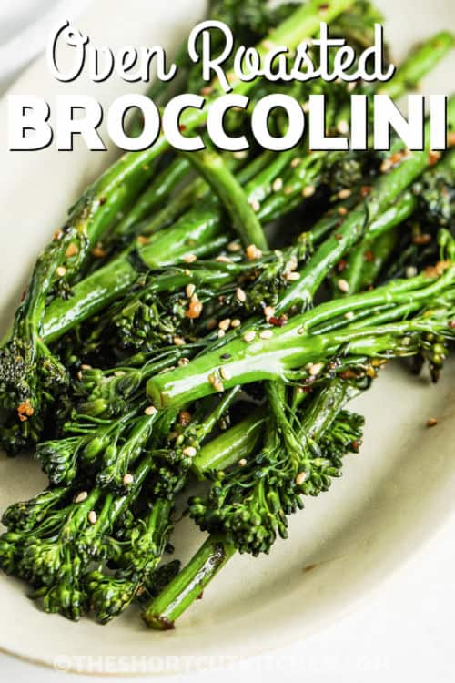 Roasted Broccolini on a plate with writing