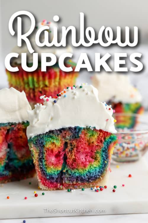 group of rainbow coloured cupcakes with text