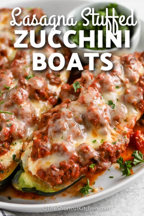 lasagna stuffed zucchini boats on plate with text