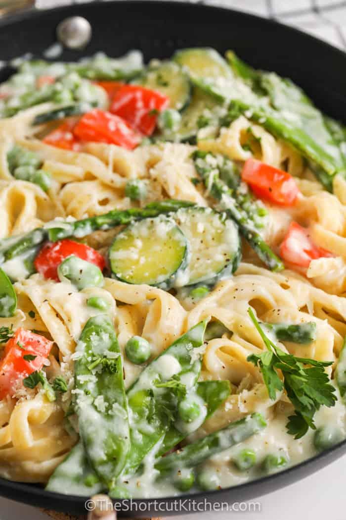 A frying pan of prepared pasta primavera